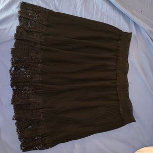 Dresses & Skirts - Short black pleated skirt with lace trim accent